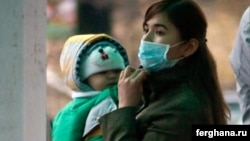 A woman wears a mask to protect herself against the flu in Bishkek.