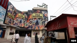 Pakistani moviegoers visit Zila Ghaziabad an Indian movie starring Bollywood star Sanjay Dutt at a cinema in Lahore.