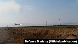 Screenshot of Azerbaijani video of Armenian combat helicopter shot down near Nagorno-Karabakh - 12Nov2014.
