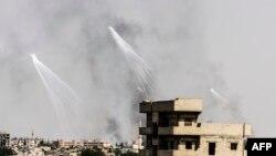 Sirija, projektili nad Rakom