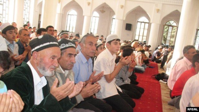 Tajikis pray in Dushanbe's central mosque during the feast of Eid al-Fitr. Islam's growing influence is showing up in the new fashion for names.