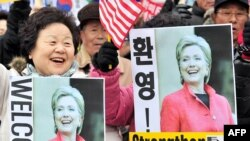 South Korean conservatives welcome the visit of U.S. Secretary of State Hillary Clinton outside the US Embassy in Seoul.