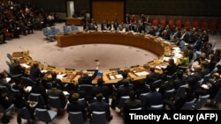 U.S. -- The U.N. Security Council votes to extend investigations into who is responsible for chemical weapons attacks in Syria at the United Nations in New York, October 24, 2017