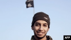Syria -- An undated picture taken from the February 2015 issue 7 of the Islamic State (IS) group online English-language magazine Dabiq, purportedly shows 27-year-old Belgian IS group leading militant Abdelhamid Abaaoud, also known as Abu Umar al-Baljiki