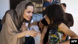 UNHCR special envoy Angelina Jolie meets with Syrian children refugees in the eastern Lebanon's Bekaa Valley near the border with Syria, 12Sep2012