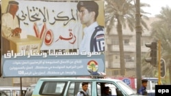 An election poster near a polling station in Baghdad