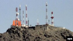 Looking higher: telecoms towers on a hilltop above Kabul