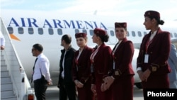 Armenia -- Air Armenia crew prepare for the company's inaugural flight from Yerevan's Zvartnots airport, 23 October 2013.