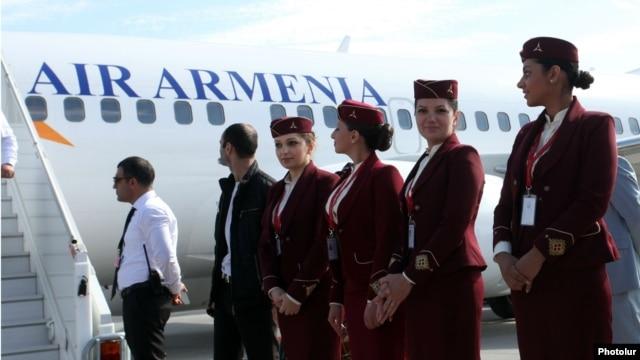 Armenia -- Air Armenia crew prepare for the company's inaugural flight from Yerevan's Zvartnots airport, 23 October 2013.