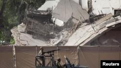 Жанкештілік жарылыстан қираған полиция кеңсесі. Пешавар, Пәкістан, 25 мамыр 2011 ж.