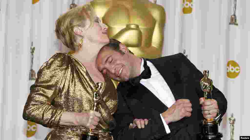 "Meryl Streep, Best Actress winner for ""The Iron Lady,"" and French actor Jean Dujardin, Best Actor winner for ""The Artist,"" pose backstage at the 84th Academy Awards in Hollywood on February 26. (Reuters/Mike Blake)"