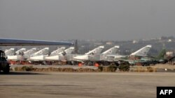 Russian fighter jets on the tarmac at the Russian Hmeimim military base in Syria's Latakia Province in February