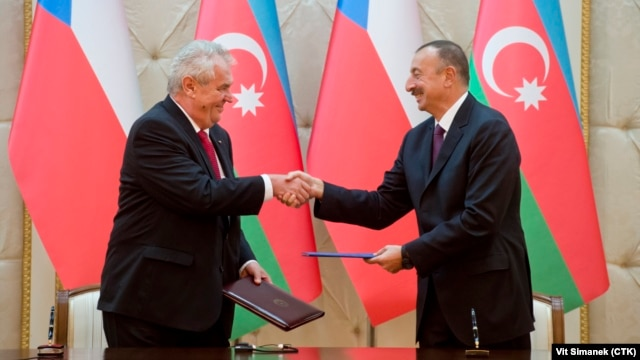Czech President Milos Zeman (left) and Azerbaijani President Ilham Aliyev shake hands after signing a declaration on strategic partnership between the two countries in Baku on September 16.