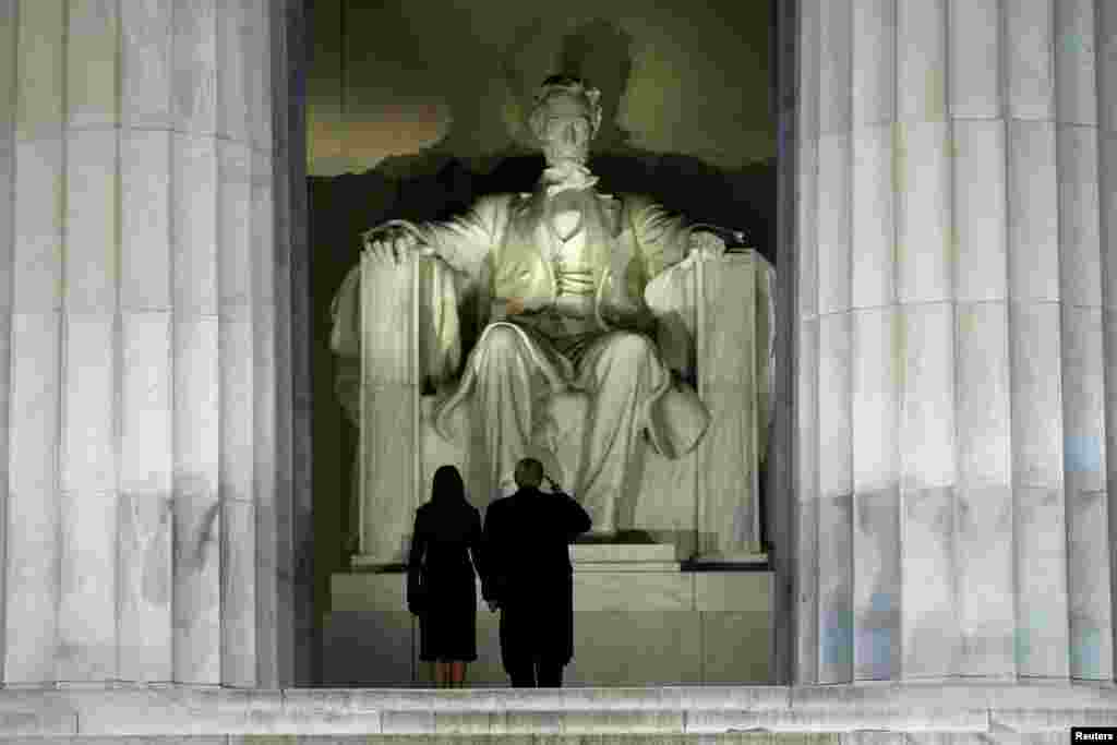U.S. President-elect Donald Trump salutes the statue of Abraham Lincoln as he and his wife, Melania, take part in a welcome concert in Washington on January 19. (Reuters/Jonathan Ernst)