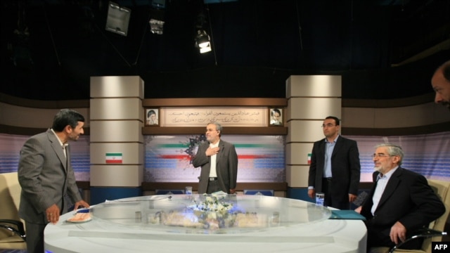 Incumbent Mahmud Ahmadinejad (left) and presidential challenger Mir Hossein Musavi (far right) in their televised debate on June 3.