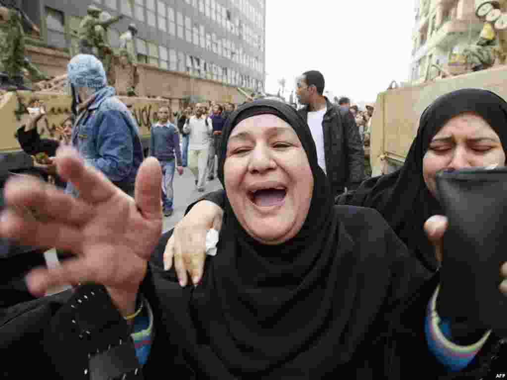 Relatives of demonstrator Mustafa Samer grieve during his funeral in Cairo on January 29.