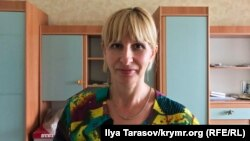 """""""[FSB officers] showed me a warrant saying that I am suspected ofhaving ties with terrorist organizations based in Ukraineproper,"""" said activist Olha Pavlenko."""