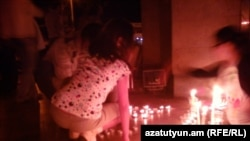 Armenia - Candles are put in a silent vigil otuside the Harsnakar restaurant in Yerevan, 30Jun2012.