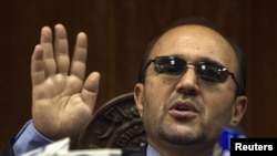 Afghanistan central bank governor Abdul Qadir Fitrat (in file photo) says he fears for his life.