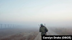 A trooper patrols along the Afghan-Tajik border.