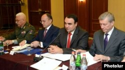 Armenia - Defense Minister Seyran Ohanian (second from left) and CSTO Secrtetary General Nikolay Bordyuzha (R) attend a conference in Yerevan, 26Jun2013.