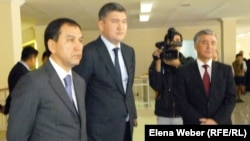 Deputy Education Minister Sayat Shayakhmetov (center) in a public appearance from late April