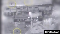 A screen grab from a video of an undated material released by the Israeli military on March 21, 2018 shows yellow circles depicting bombs during what the military describes is an Israeli air strike on a suspected Syrian nuclear reactor site near