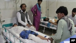 A wounded men receives treatment in a hospital after a suicide attack on the outskirts of Jalalabad on June 13.