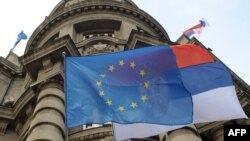 Serbia -- The EU flag hangs in front of the Serbian government building in Belgrade, March 2, 2012