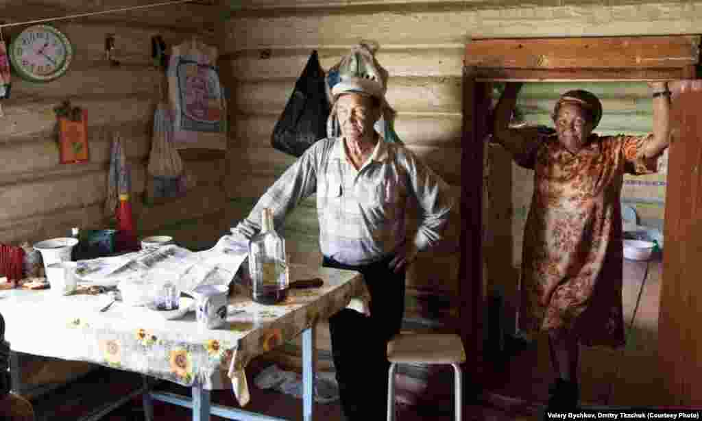 A family shows off the cozy comforts of home in one of the traditional local houses.