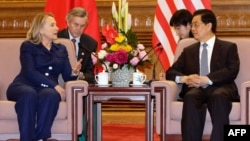 U.S. Secretary of State Hillary Clinton (left) speaks with China's President Hu Jintao during a meeting at the Great Hall of the People in Beijing on May 4.
