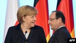 Ангела меркел ва Франсуа Олланд