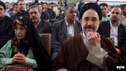 Former President Mohammad Khatami sits next to the wife of candidate Mir Hossein Musavi, Zahra Rahnavard, during a reformist gathering in Tehran before the elections.
