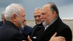 Iran's Foreign Minister Mohammad Javad Zarif, left, greets by Lebanese Hezbollah lawmaker, Ali Ammar, upon his arrival at Rafik Hariri Airport, in Beirut, Lebanon, Sunday, Feb. 10, 2019. Zarif said his country is ready to cooperate with the new Lebanese g