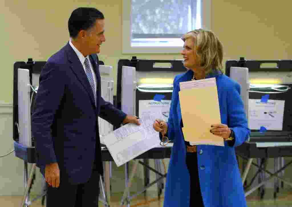Republican presidential nominee Mitt Romney and his wife, Ann, finish filling out their ballots while voting in Belmont, Massachusetts.