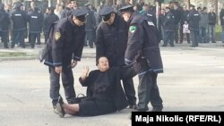 Bosnian police arrest a protester in Tuzla on February 5.