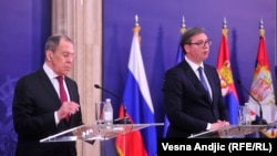 Russian Foreign Minister Sergei Lavrov (left) and Serbian President Aleksandar Vucic speak to reporters after meeting on June 18 in Belgrade.