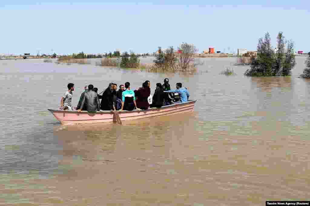 A boat carries residents of Golestan Province on March 24.