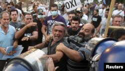 Demonstrators scuffled with the police in the Cypriot capital, Nicosia, in late April after lawmakers approved an EU bailout.