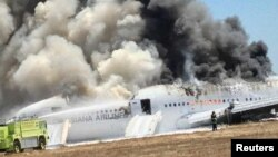 U.S. - Asiana Airlines Boeing 777 is fully engulfed on the tarmac after crash landing at San Francisco International Airport in San Francisco, California on July 6, 2013