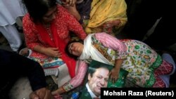 A supporter of Pakistani Prime Minister Nawaz Sharif passes out after the Supreme Court's decision to disqualify Sharif in Lahore on July 28.