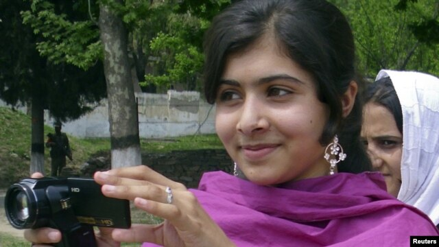 Malala Yousafzai, the 14-year-old schoolgirl targeted in the October 9 gun attack, is seen in Swat Valley in an undated photo.