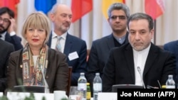 Abbas Araghchi (right), political deputy at the Iranian Foreign Ministry, and the secretary-general of the European Union External Action Service (EEAS), Helga Schmid, attend the Vienna meeting on February 26.