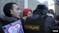 """Gay-rights activists hold a protest outside the State Duma in January as a new law against disseminating """"homosexual propaganda"""" to minors was being debated by Russian legislators."""