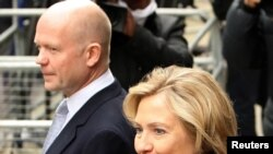 U.K. Foreign Secretary William Hague (left) and his U.S. counterpart Hillary Clinton arrive for talks in London on March 29.