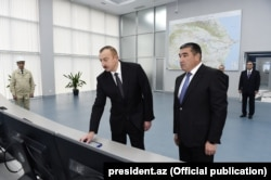 President Ilham Aliyev (left) launches the newly renovated Mingacevir hydroelectric power station in February 2017.