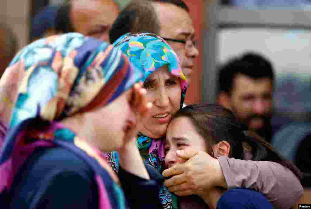 Relatives of the victims mourn in front of a morgue in Istanbul.