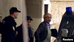 Serbia -- Tycoon Miroslav Miskovic (R) is detained by police in Belgrade, 12Dec2012