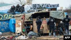 Authorities will begin dismantling makeshift shelters at the Calais camp by hand before sending in bulldozers to complete the job. (file photo)