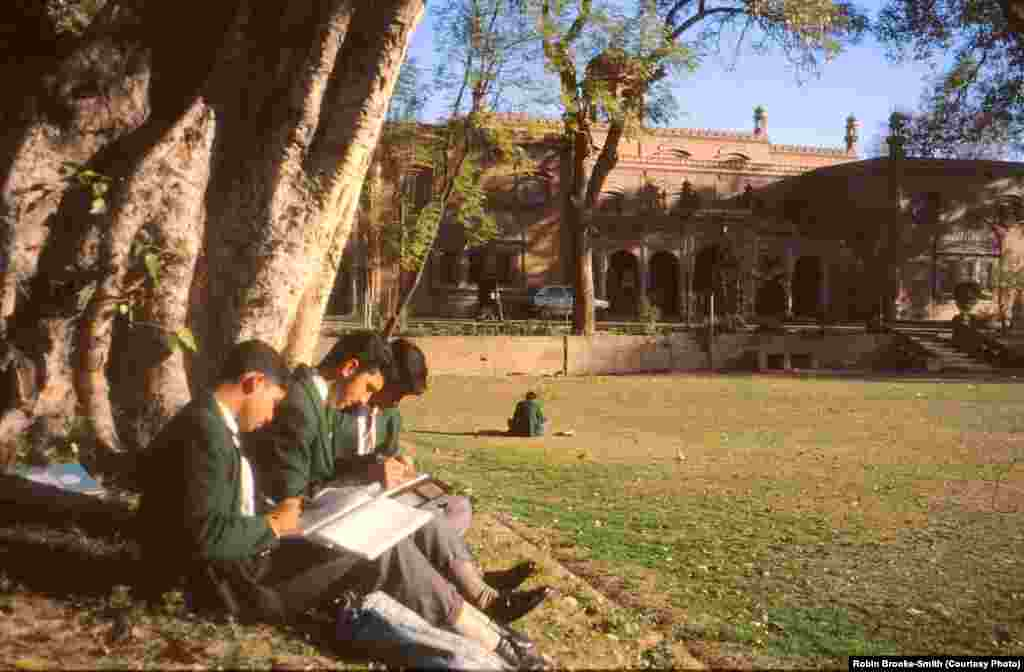 Students enjoying the winter sun by the tennis court.
